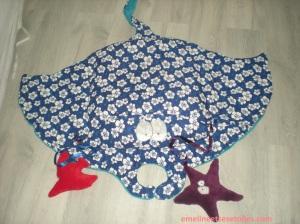 Une gentille raie toute rembourrée de billes pour s'asseoir avec son étoile et son poisson (jouets sonores)